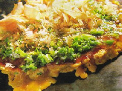 Negi Okonomiyaki. The flakes on the top are katsuobushi